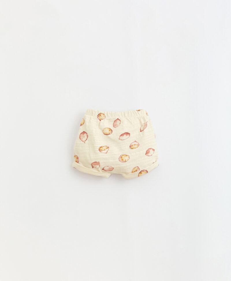 Pantalón corto estampado en algodón orgánico de Play Up - detrás